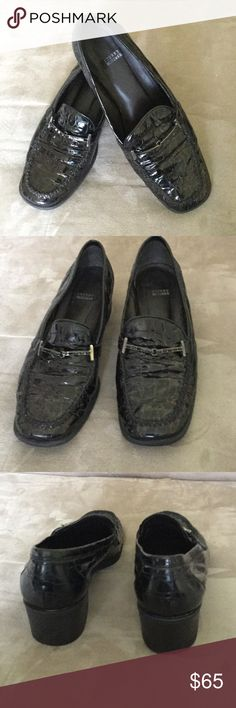 Stuart Weitzman 6W black patent leather loafers Classic, sophisticated, and comfortable Stuart Weitzman 6W black patent leather loafers from Spain Picture of 1 1/2 inch heel and a black rhinestone studded buckle detail across top of foot. Stuart Weitzman Shoes Flats & Loafers