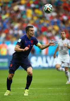The Flying Dutchman - Robin van Persie of the Netherlands lines up the ball prior to scoring his teams first goal with a header in the first half during the 2014 FIFA World Cup Brazil Group B match between Spain and Netherlands at Arena Fonte Nova on June 13, 2014 in Salvador, Brazil. (Ian Walton/Getty Images)