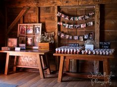 Great ideas for wedding reception decorations. Navy Hall is super rustic with lots of character. Old photographs hanging from twine, and jars of jam for wedding favors. #JoshBellinghamPhotography