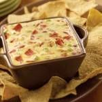 Crock-Pot Amy's World Famous Pepperoni Dip – Just three simple ingredients and you have this luscious recipe for Crock-Pot Amy's World Famous Pepperoni Dip. Dip your favorite chips or chunks of bread in this warm dip. | from CrockPotLadies.com