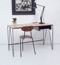 The compact Study desk is made from steel and OSB. This one features clear lacquered steel bar zigzag legs ending in protective cork feet. The floating pigeonhole under the table top is the perfect size to hold a laptop, paperwork or magazines. The desk top is made of plywood finished with protective beeswax. At just over 1m wide it fits neatly into the smallest studio or apartment. Designed by