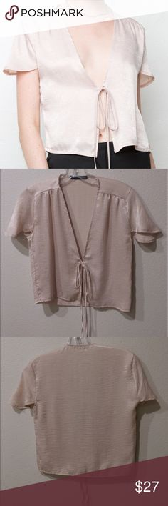 Brandy Melville Leesa Silky Top Bought at the Brandy Melville store in London, never worn. Very light and airy. Faux silk. Gorgeous rose-tinted champagne color. One size that fits small/medium, however fit is adjustable with the tie front. Brandy Melville Tops Crop Tops