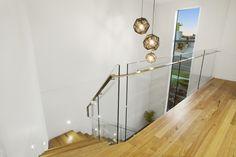 Firestreak messmate timber floors and glass balustrade. #minimalistdesign #customhome #pivothomes
