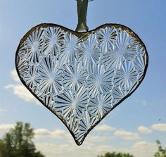 Hand made clear textured glass heart suncatcher with red ribbon