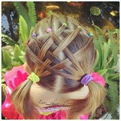 Girls woven sections into pony tails at bottom