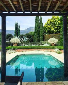 honed granite columns sunk into pool