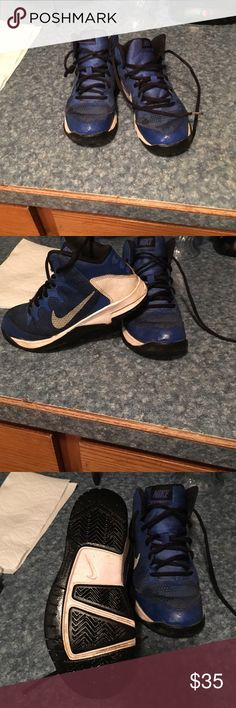 Boys youth size 2 basketball shoes Used 4 times boys youth basketball shoes in great condition and no stains or rips the different color ration on the right shoe is just water Nike Shoes Athletic Shoes