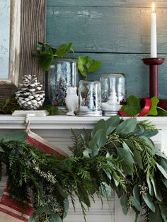 Give Mason jars a farmhouse-chic makeover by filling them with mini trees and snow, then placing them on your mantel. #christmasdiy #christmasideas #holidaydiy