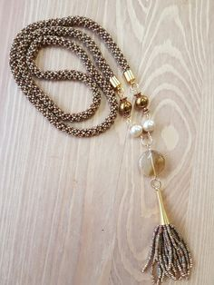 Miyuki made necklace  with gold findings.