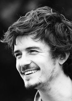 Orlando Bloom - medium length scissor cut all over. Works best with naturally wavy to curly hair.