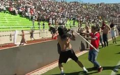 Watch as Colo Colo and Santiago Wandrers football fans clash with sticks,   rocks and seats torn from the stands, forcing officials to cancel the match