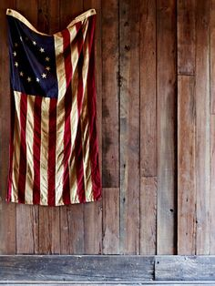 Using an american flag as a decoration can be a touchy subject. I've hung a flag on my wall in every place I've ever called home because I love being able to look at it everyday.