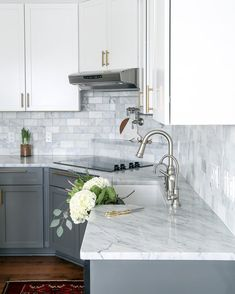 Two-toned gray and white cabinets, marble subway tile, Carrara countertops, a big farmhouse sink, and brass hardware give this kitchen a classic yet modern look. marble Gray and White and Marble Kitchen Reveal - Maison de Pax Kitchen Cabinet Design, Kitchen Remodel, Modern Kitchen, White Marble Kitchen, Farmhouse Kitchen Cabinets, Home Kitchens, Kitchen Renovation, Kitchen Cabinets Makeover, Kitchen Design