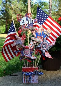 Fun 4th of July centerpiece, with a nice mix of flags, pinwheels, and stars.