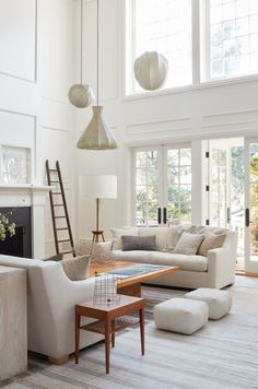 tonal whites in the living room with a trio of pendants | modern colonial farmhouse tour on coco kelley