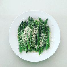 Blanche asparagus drizzled with a lemon & buchu dressing and topped with grated parmesan