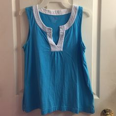 Blue Lilly Pulitzer Arya Tank Top Only worn once. Beautiful top for summer. Adds an extra ounce of Lilly to any outfit without the bold print. Has a beautiful v neck with white outlining. Size XS but fits like a medium Lilly Pulitzer Tops Tank Tops