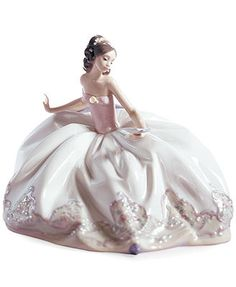 The spring ball awaits this young beauty. Draped in a long, flowing dress and pink wrap, Lladro's graceful porcelain figurine evokes all the excitement and wonder of a first dance. | Porcelain | 8"