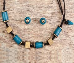 Simple handmade terracotta jewelry painted in blue & gold looks great for all the outfits https://www.facebook.com/KavisTerracottajewellery