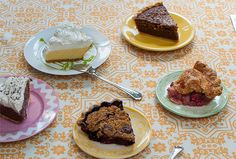 """Top row, right to left: Key Lime pie from Town Topic and MoKan nut pie from Rye. Middle: Chocolate cream pie from Town Topic, """"Bumbleberry"""" and rhubarb slices from The Upper Crust Pie Bakery."""