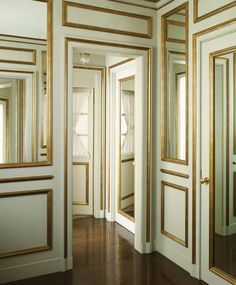 Doors and mirrors create an elegant gold and mint interior...
