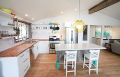 White, open shelving, butcher block, turquoise island
