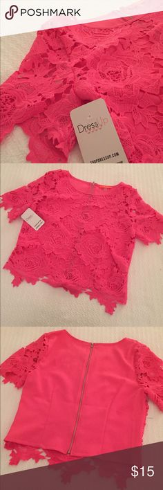 Beautiful hot pink lace overlay shirt! Brand new! Bought this adorable lace top from Dress Up and love it, but sadly it does not fit me. Still has the original tags and is in perfect condition. Perfect for wearing over a cute tank with jeans or even a little black dress to add some color. This is a shorter top, not crop though, and there is not a lining under the lace. Beautiful! Dress Up Tops Crop Tops