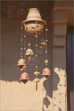 images of clay pot windchimes | Pics of a decorative ceramic wind chime with leaf design hanging from ...