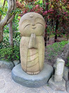Hase-Dera Buddist Temple in Kamakura, Japan.  Thousands of Jizo statues left by parents mourning the loss of a baby.  Someday.