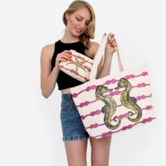 """Sea Horse Canvas Beach Tote Bag This spacious tote fits comfortably over the shoulder and is perfect for carrying all your beach essentials. Features adorable Sea Horse print on both sides. Height:13.5"""", width: 29.5"""", depth: 6.5"""". It has 3 inner pouch pockets. D ring on the side for clipping keys. Inner snap closure. 100% cotton canvas outer, blue nylon lining with T/F logo. Retails for $75. Comes to you in its sealed packaging with tags attached. Thursday/Friday Bags Totes"""