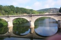 Bicycle Touring in France in the Dordogne region, here we cross the river.