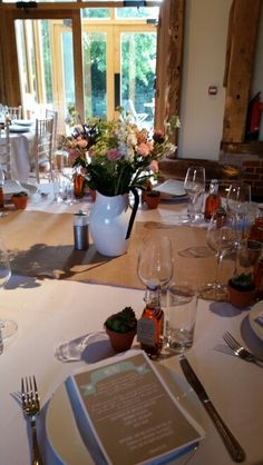 Tables decorated with country garden flowers and succulents