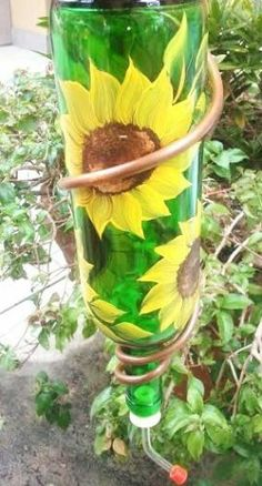 """Hummingbird Feeder-""""Up Cycled Wine Bottle"""" with Hand Painted Sunflower Design  Inspiration image Use nontoxic glass paint. Hummingbirds are most attracted to the color red, but also yellow and blue."""