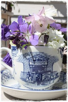 Love this idea...cup full of flowers..great in kitchen..