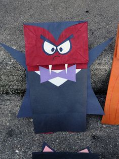 Funny paper sack puppets on Make and Takes.