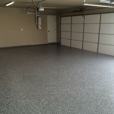 Silver epoxy base with asphalt flakes topped off with a poly aspartic coating.