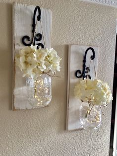 This is a beautiful set of 2 mason jar wall sconces. It includes two sconces, hanging mason jars and flowers. The sconce measures 14 tall and 5.5 wide. FLOWERS AND LIGHTS INCLUDED!! Scroll through the listing to see your flower color and sconce finish options. Please leave me a note in the notes to seller box with your flower color choice or you will receive the flowers pictured in pic 1 which are Antique White. These make lovely housewarming gifts and are the perfect addition to your homes…