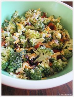 Man I love broc salad ({broccoli salad}... •2 heads fresh broccoli •1/2 cup red onion, chopped •1/2 pound bacon •1 1/2 cups grated cheddar cheese •1/2 to 3/4 cup of raisins •2 1/2 tablespoons vinegar •1 cup mayonnaise •1/3 cup sugar)$