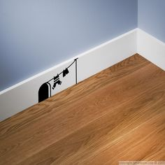 Mouse hole and laundry wall decal.