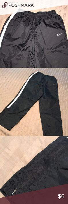 Light weight NIKE running pants Wind breaker style. Not lined. Has side zip at ankles for easy to get over shoes. Nike logo. No holes rips or tears. Great condition. Check out my other Nike items. Nike Pants