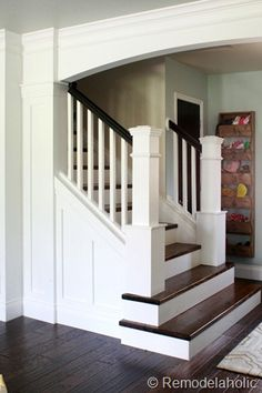 Stair Makeover removing carpet from stairs custom newel posts remodelaholic.com #stairs #DIY #wood_stairs