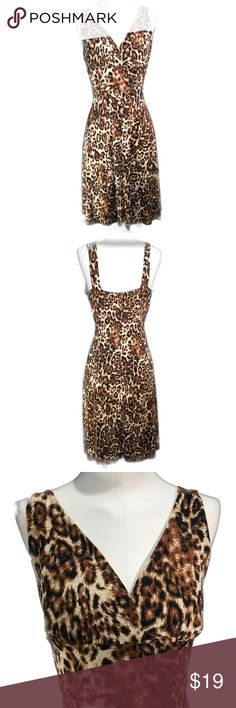Leopard Print Dress Nice Leopard Print Dress perfect for anytime of day. Nice stretchy material, has a nice floaty feel and fits very well.  92% Polyester  8% Spandex 41 inches shoulder to hem Marianne Dresses