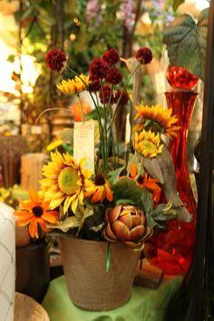 fall floral arrangement with yellow sunflowers / artichokes / terra-cotta pot / silk floral arrangement