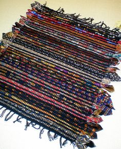 Handwoven neck tie rug... Awesome - but do I have the patience? No tutorial but I'm sure a loom is a must...