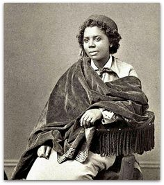 Edmonia Lewis was the first African American artist to earn international fame for her artwork.    She earned a living as a sculptor and portraitist and was famous for several of her works, including a bust of Colonel Robert Gould Shaw of which she sold over 100 plaster copies.    Born Mary Edmonia Lewis in 1844 in New York State, Edmonia was actually African American and Native American. Her mother was of Mississauga Ojibwe and African descent, while her father was Haitian of African…