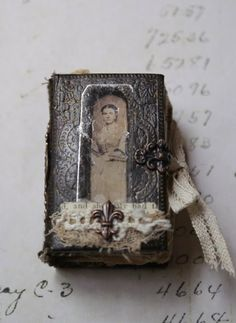 tiny handmade book-could be a pretty little retablo idea