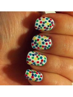 Nail polish idea: multicolor polka dots  Here's a fun nail-art twist on the traditional polka-dot palette.