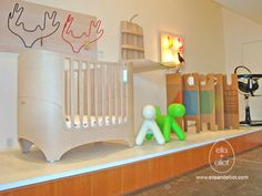 """Our hip Leander Crib display features Antlers coat hooks, """"Puppy"""" by Eero Aarnio, Enzo Mari's cardboard wall, our Folding Changing Table, Pigeon Lights and a black Fresco loft. Extra Rooms, Simple Rules, Coat Hooks, Baby Cribs, Spring Cleaning, Feng Shui, Fresco, Toddler Bed"""