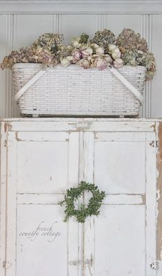 FRENCH COUNTRY COTTAGE: Vintage Basket - good idea for large basket/paint old basket