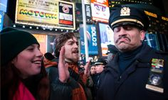 A policeman reacts as people protest against the Eric Garner decision NYC